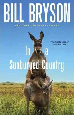 In A Sunburned County by Bill Bryson book cover with kangaroos and blue sky with green grass