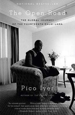 The Open Road by Pico Iyer book cover with monk sitting in a chair in the middle of the room