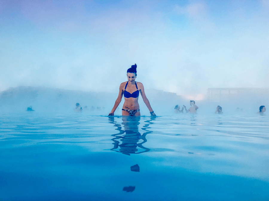 Brunette woman in a bikini in blue water at the Blue Lagoon Spa