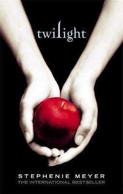 Books Set In Every State Washington, Twilight by Stephanie Meyer, book cover with pale white hands holding a vibrant red apple