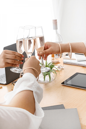 Blogger tricks picture of cheering with wine glasses as friends