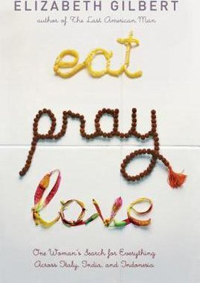 Eat Pray Love by Elizabeth Gilbert book cover with words written in pasta, flowers, and prayer beads