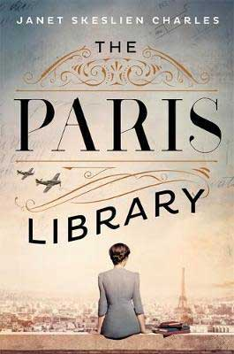 The Paris Library by Janet Skeslien Charles book cover with a brunette woman in a blue dress looking out at the Eiffel Tower sitting next to a stack of books