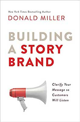 Building A StoryBrand by Donald Miller white book with red and white megaphone