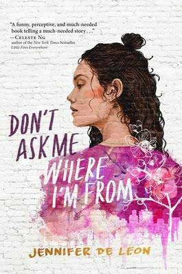 Don't Ask Me Where I'm From by Jennifer De Leon book cover with young woman with curly brown hair wearing a pink shirt made of flowers and trees