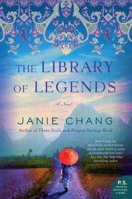 The Library Of Legends by Janie Chang book cover with woman carrying a red umbrella and walking down a path surrounded by mountains