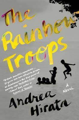 The Rainbow Troops by Andrea Hirata book cover with yellow writing and shadows of children jumping in implied water