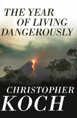The Year Of Living Dangerously by Christopher Koch book cover with volcano eruption and red lava